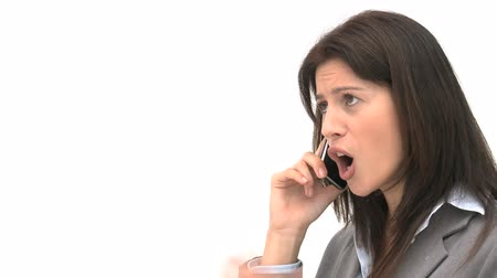 сердитый : Angry businesswoman talking on the phone isolated on a white background