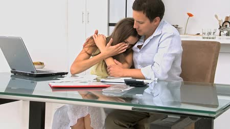 banknoty : Woman crying in the arms of her boyfriend because of their bills
