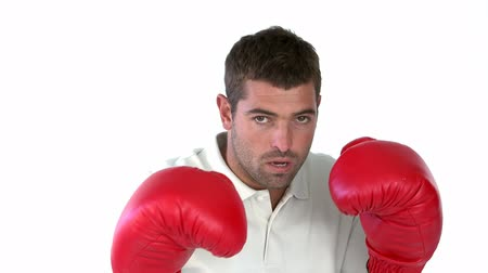 puncs : Charismatic man with boxing gloves against a white background