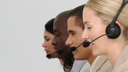 segítség : Team of people working together in a call centre