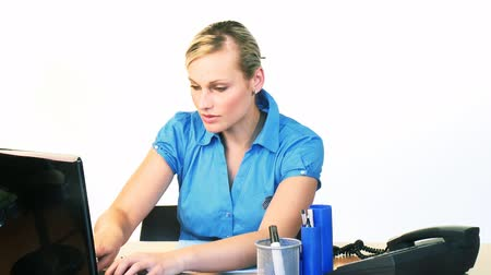 employee : Beautiful blonde businesswoman using a laptop in office footage