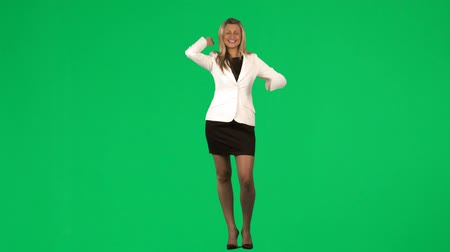 bizneswoman : Happy businesswoman celebrating a success against green screen footage