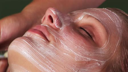 лицевой : Facial massage at a hotel spa healthclub