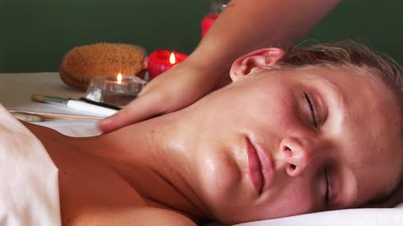 massages : Attractive young Woman getting her neck massaged Stock Footage