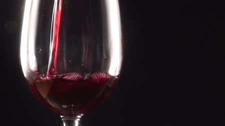 pour out : Stock Footage  - Pouring a glass of red Wine