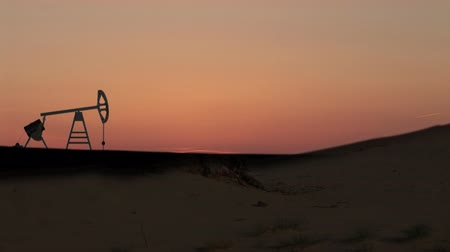rigs : Oil pumping against red sky