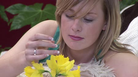 bas : Stock Video Footage of a Woman Smelling a Flower