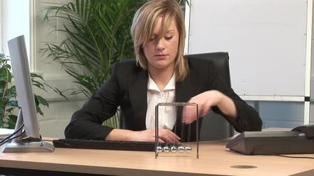 unott : Stock Video Footage of a Receptionist Bored in the office Presentation