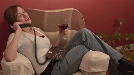 sitting room : Stock Footage of a Woman Relaxing with a Glass of Wine