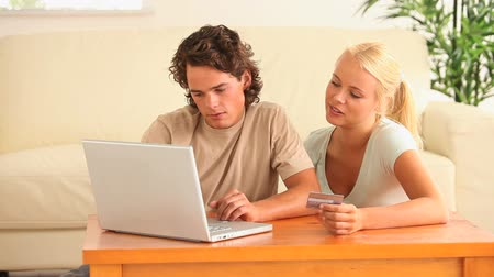 payment : Couple buying online in the living room