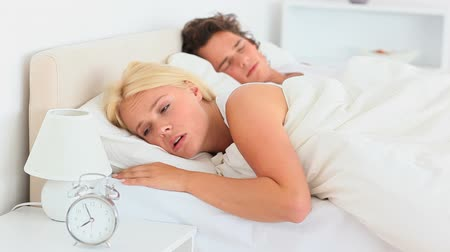 probudit : Couple not wanting to wake up in the bedroom