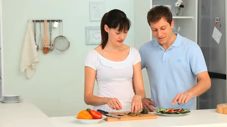 cooks : Young couple having a little argument in the kitchen Stock Footage