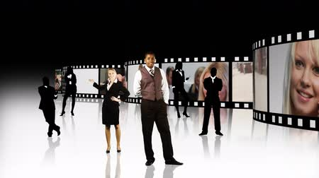 kino : Business film strip. Business people standing in front of a film showing meetings and people working in business