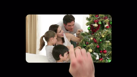dekoracje : Finger activating and scrolling through christmas videos against a black background Wideo