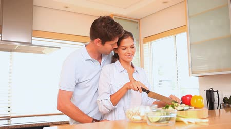 gotowanie : Young couple cooking in the kitchen