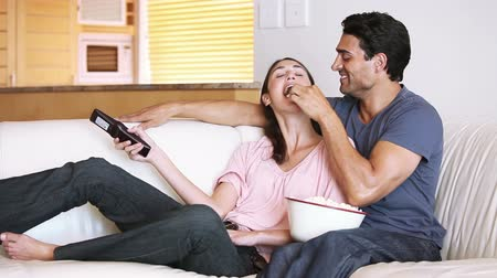 feed on : Couple watching the television in their living room