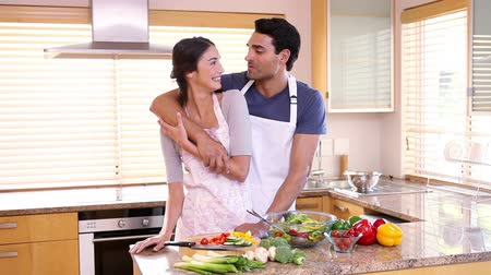 persiana : Couple hugging each other in the kitchen Stock Footage