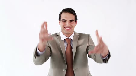 банк : Happy businessman throwing bank notes against a white background