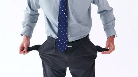 üres : Sad man showing his empty pockets against a white background Stock mozgókép