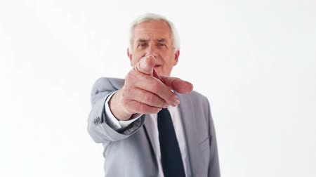 pont : Serious man pointing his finger against a white background