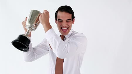 sampiyonlar : Smiling man holding his cup against a white background Stok Video