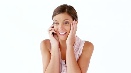 telefones : Smiling woman using a cellphone against a white background