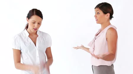 argumento : Women having a disagreement against a white background