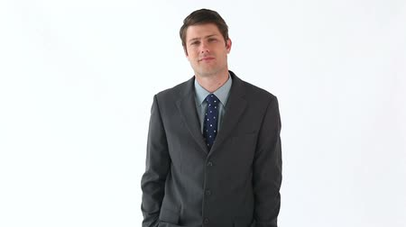 bolso : Serious man placing his hands in his pockets against a white background