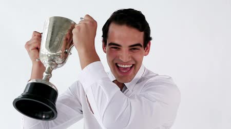 sampiyonlar : Smiling businessman holding a cup against a white background
