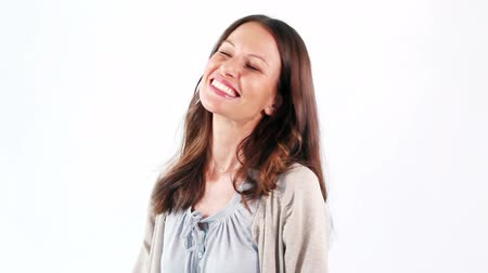 tongue out : Happy woman sticking out her tongue against a white background Stock Footage