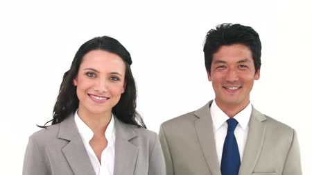 японский : Two business people posing against a white background