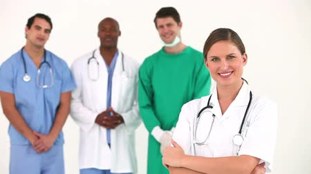 orvostudomány : Hospital team posing together against white background