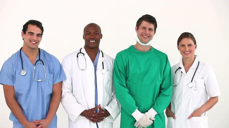 ilaçlar : Hospital team standing together while posing against a white background