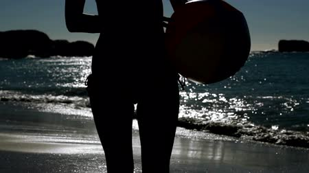 mehtap : Woman playing with a beach ball under the moonlight on the beach