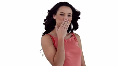 üfleme : Woman flirting while looking at the camera against a white background Stok Video