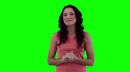 gülümseyen : Woman making an announcement against a green background