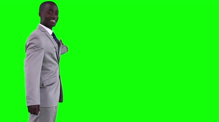 walking man : Businessman gesturing towards a virtual object against a green background