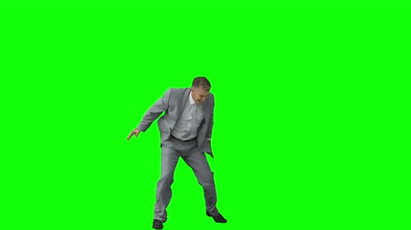 jump : Happy businessman in slow motion raising his arms against a green background