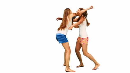 ragaszkodás : Two girls hugging each other in slow motion against a white background