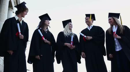 čepice : Graduated students throwing up their hats in a sky background Dostupné videozáznamy