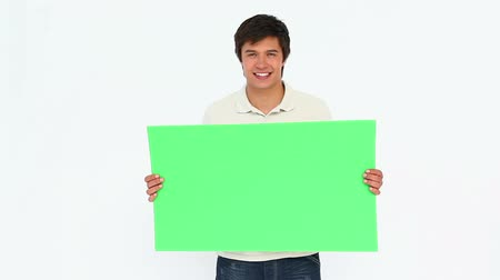 holding : Man holding a sign against white background Stock Footage