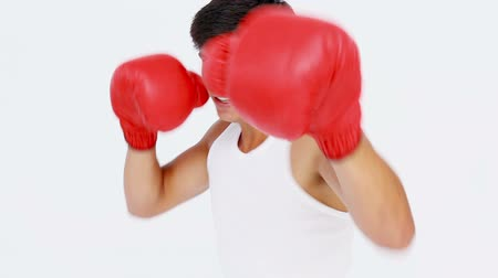 sportsmen : Man boxing with red gloves while looking at camera Stock Footage