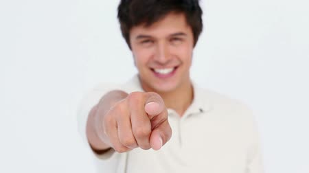 точка зрения : Man pointing at the camera against white background