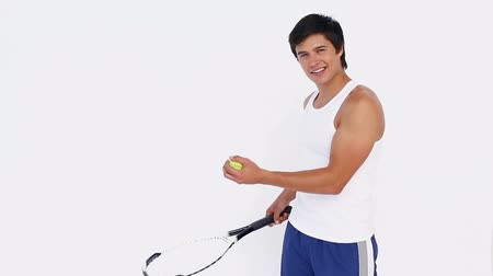 ракетка : Tennis player bouncing ball on racket against white background Стоковые видеозаписи