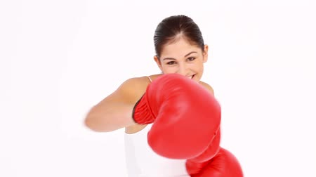 boxe : Laughing woman trying to box against white background