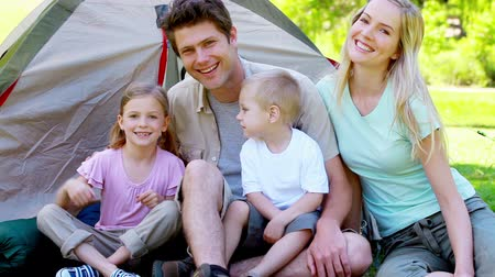 posando : Family posing together in front of a tent Stock Footage