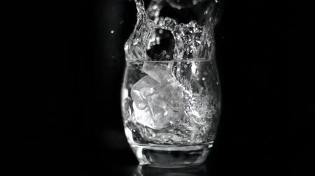 wódka : Vodka splashing in super slow motion against black background Wideo