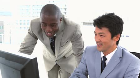 business man : Colleagues working together on a computer in a office