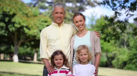 outdoor : Couple with two children posing in a park