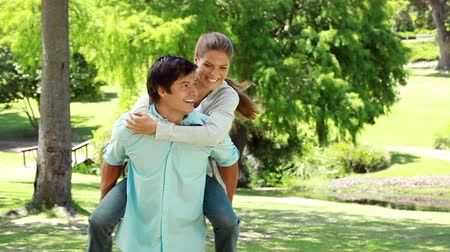 namorado : Happy man holding his lovely girlfriend in the countryside